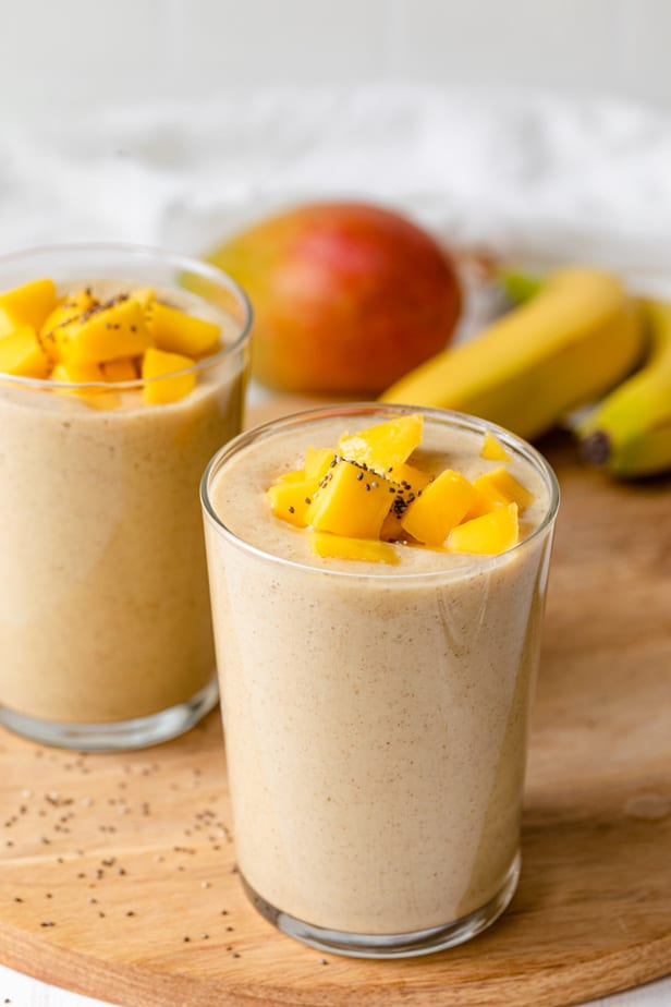 Two glasses of banana and mango smoothies