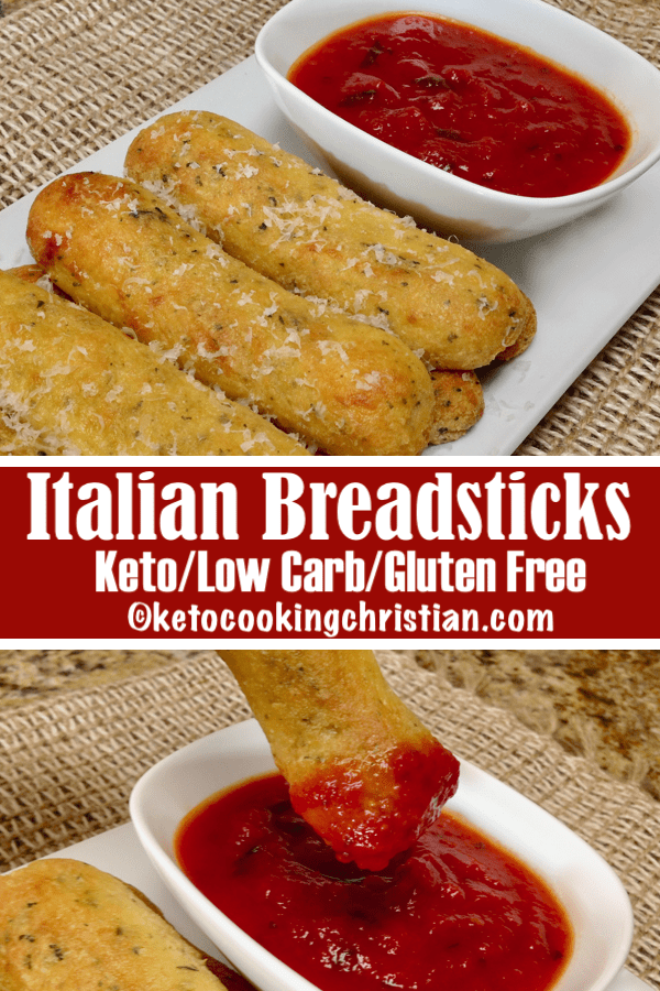 breadsticks with grated cheese on top and marinara sauce in a bowl next to it