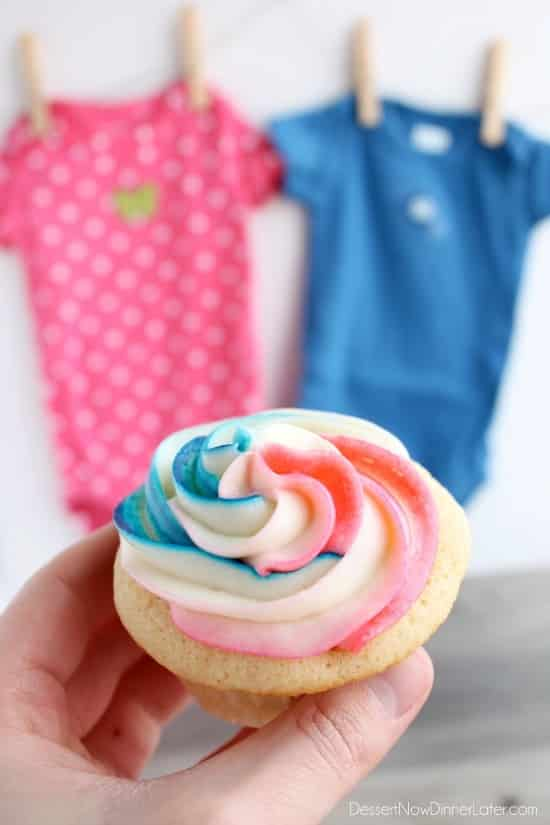 These gender reveal cupcakes have a pink, blue, and white swirl icing on top that hides the secret heart of color in the center of the cupcake that reveals baby's gender when you bite into it! (Step by step photographic tutorial)