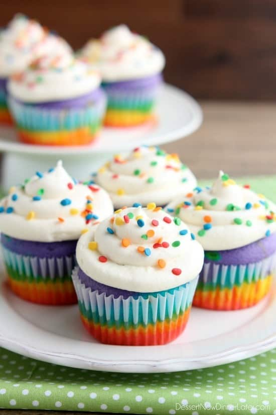 These Rainbow Cupcakes are made with a simple boxed white cake mix, colored and layered to make a rainbow, with whipped cream cheese frosting on top. (Photo tutorial, plus tips for baking cupcakes to perfection!)