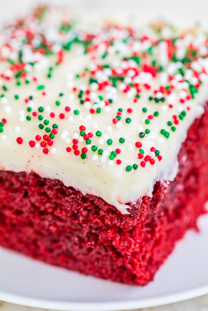 Red Velvet Cake: Red velvet cake soaked in sweetened condensed milk and chocolate and topped with a quick homemade cream cheese frosting. So good! Great for shared meals and vacations. #redvelvetcake #dessert #cakerecipe #christmas #valentinesday