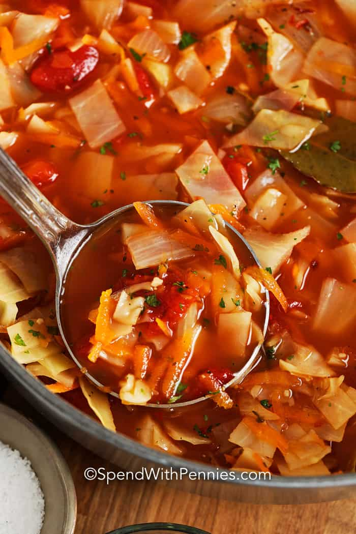 Close up of cabbage soup in a serving spoon.