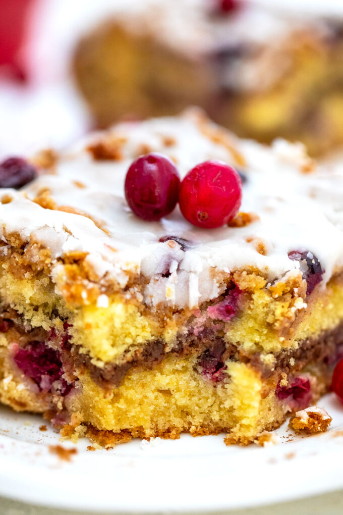 Cranberry Coffee Cake is the perfect fall dessert to pair with your favorite coffee! It is moist, sweet and sour at the same time, and very easy to make! #coffeecake #cranberries #falldesserts #sweetandsavorymeals #thanks