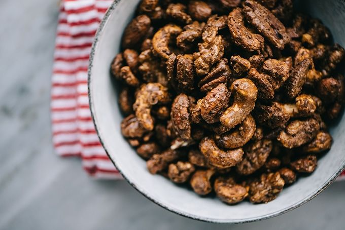 A bowl of paleo and unsweetened gingerbread with nuts flavored with a red and white linen napkin.