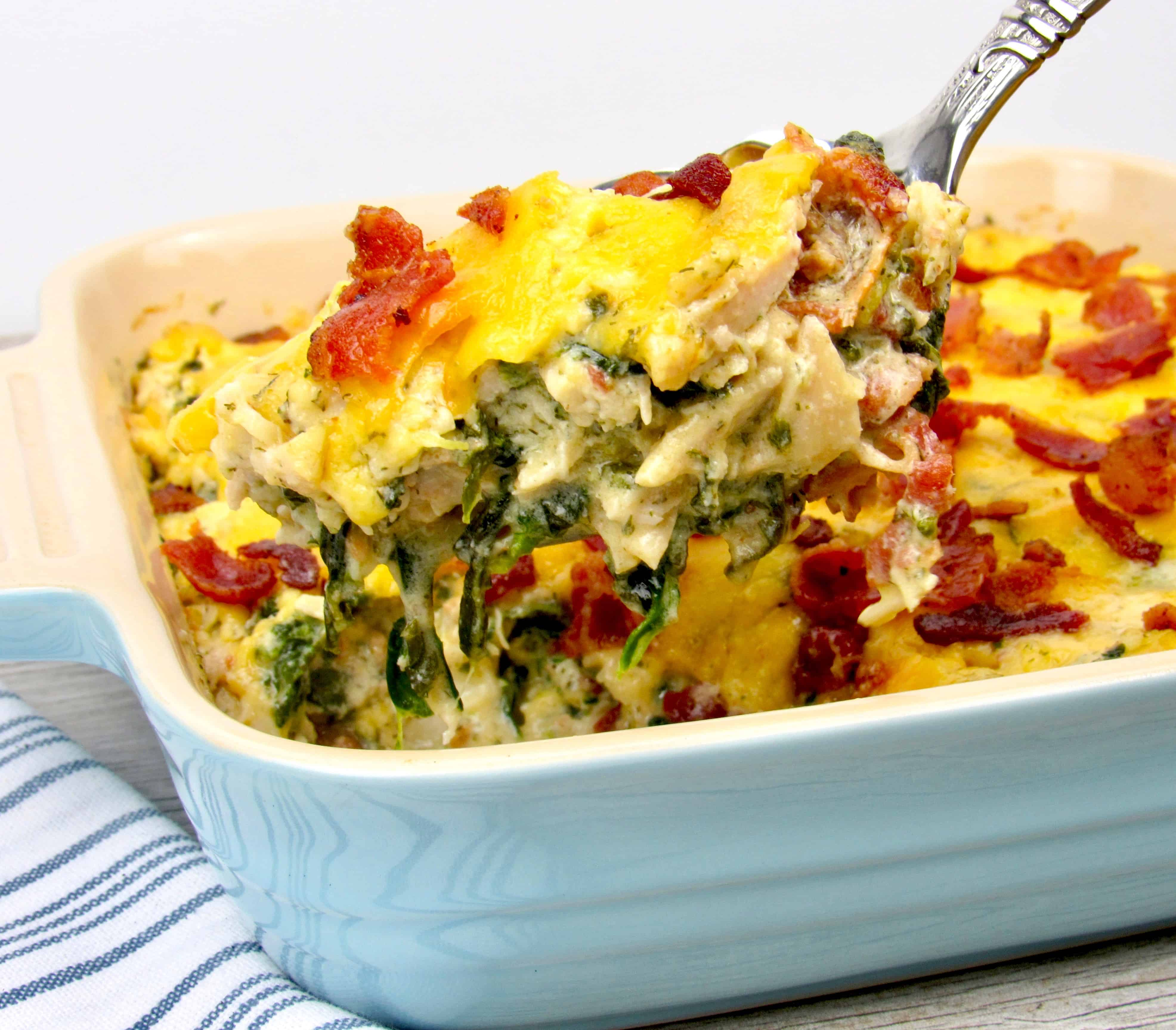 ladle chicken pan with cheese and bacon on top