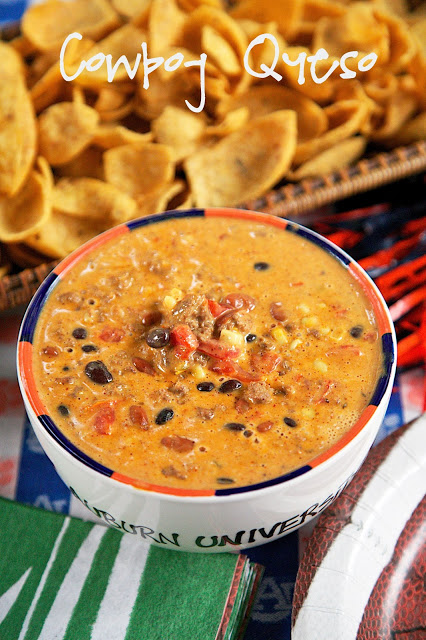 Spicy cheese dip - only 4 ingredients! This is crazy! It is a must at any party! Sausage, white cheese sauce, black beans and diced tomatoes and green chilies. Everyone LOVES this easy Mexican sauce!