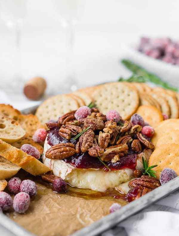 This baked Brie recipe with cranberry sauce and candied bourbon nuts will be your new favorite recipe for entertainment. Perfect for Thanksgiving or Christmas ... it's easy to make and absolutely irresistible!