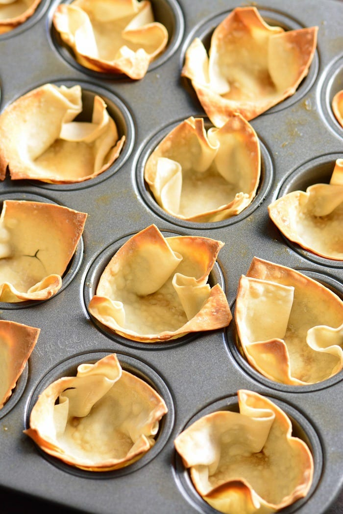 Wonton cups with guacamole. Simple and tasty party snack. They're made with wonton wrappers, stuffed with homemade guacamole, and topped with crumbled Cotija cheese. #appetizer #snack #avocado #guacamole #individual