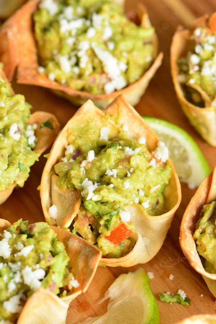 Guacamole cups. Simple and tasty party snack. They're made with wonton wrappers, stuffed with homemade guacamole, and topped with crumbled Cotija cheese. #appetizer #snack #avocado #guacamole #individual