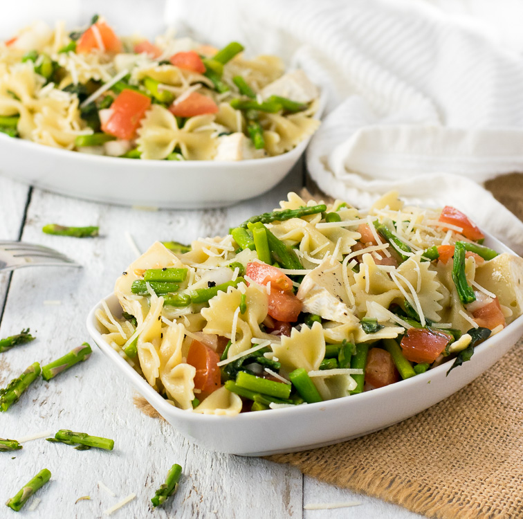 Warm pasta salad with asparagus and brie cheese