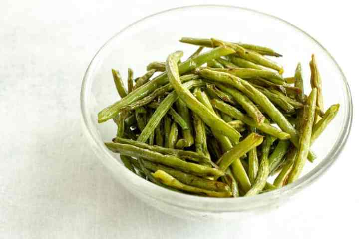 glass bowl of baked green beans