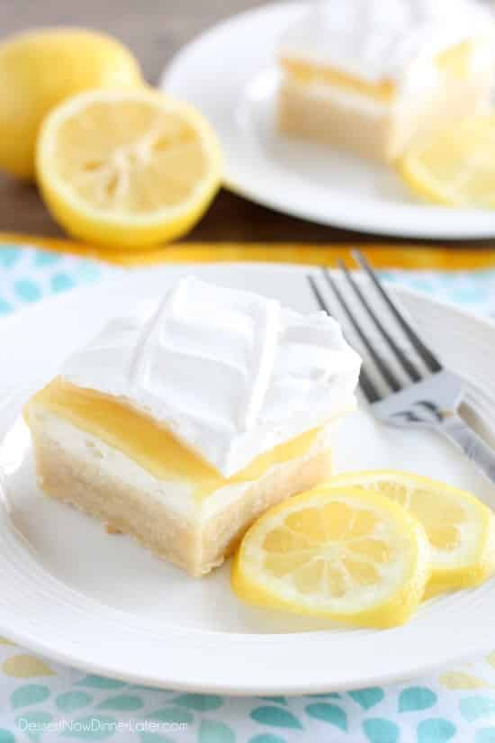 This lemon curd dessert has a sweet butter crust, a rich layer of cream cheese, spicy lemon curd, and fresh whipped cream. A perfect combination of bittersweet flavors!