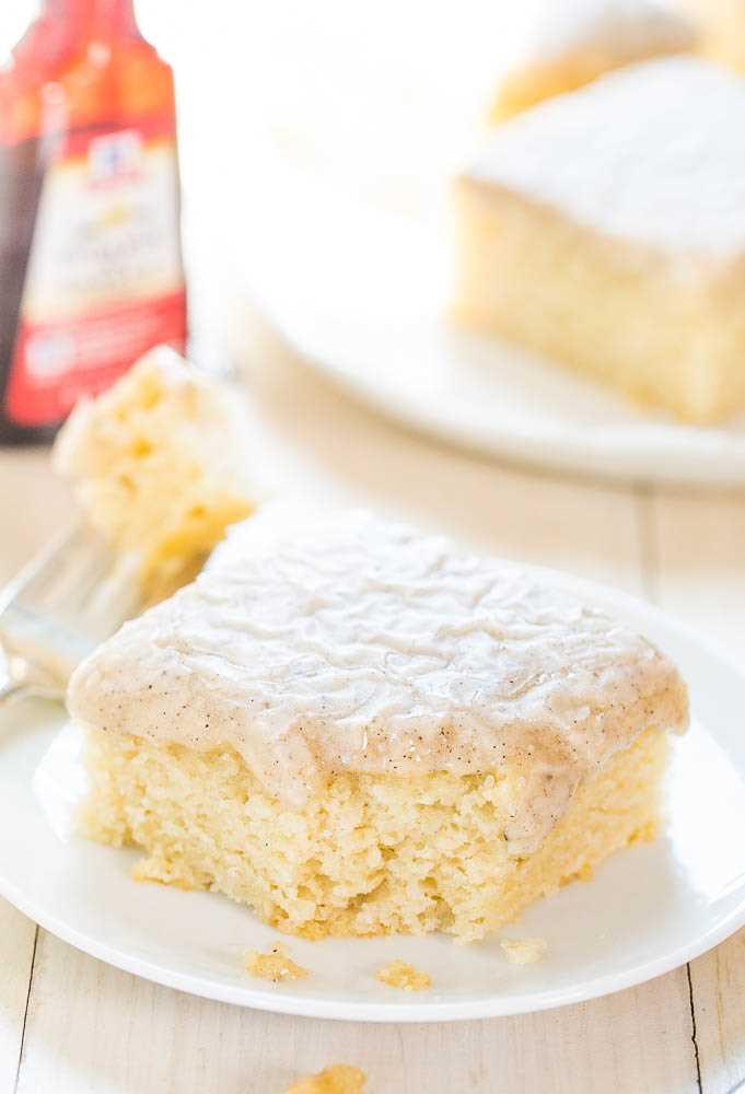 Homemade slice of vanilla cake on a white plate