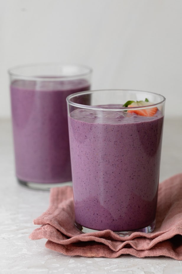 Two cups of mixed berry smoothie